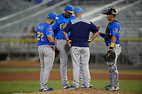 Myrtle Beach Pelicans pitching coach Brian Lawrence (51) talks with pitcher Erling Moreno (50) as third baseman Cam Balego (22) and catcher Miguel Amaya (9) listen in during a Carolina League game against the Potomac Nationals on August 14, 2019 at Northwest Federal Field at Pfitzner Stadium in Woodbridge, Virginia.  Potomac defeated Myrtle Beach 7-0.  (Mike Janes/Four Seam Images)