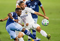 CARSON, CA - OCTOBER 18: Cristian Dajome #11 of the Vancouver Whitecaps and Emiliano Insua #3 of the Los Angeles Galaxy get after a ball during a game between Vancouver Whitecaps and Los Angeles Galaxy at Dignity Heath Sports Park on October 18, 2020 in Carson, California.