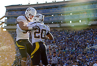 Spencer Hagan of California celebrates with Isi Sofele of California after Sofele scored a touchdown during the game against UCLA at Rose Bowl in Pasadena, California on October 29th, 2011.  UCLA defeated California, 31-14.