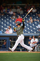 Nashville Sounds left fielder Renato Nunez (34) follows through on a swing during a game against the New Orleans Baby Cakes on April 30, 2017 at First Tennessee Park in Nashville, Tennessee.  The game was postponed due to inclement weather in the fourth inning.  (Mike Janes/Four Seam Images)