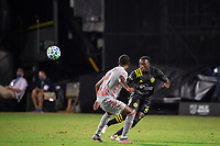 LAKE BUENA VISTA, FL - JULY 16: Derrick Etienne #22 of the Columbus Crew SC kicks the ball during a game between New York Red Bulls and Columbus Crew at Wide World of Sports on July 16, 2020 in Lake Buena Vista, Florida.