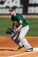 Siena Saints first baseman Kyle Baldani #27 holding a runner on during a game against the UCF Knights at the UCF Baseball Complex on March 3, 2012 in Orlando, Florida.  UCF defeated Siena 6-4.  (Mike Janes/Four Seam Images)