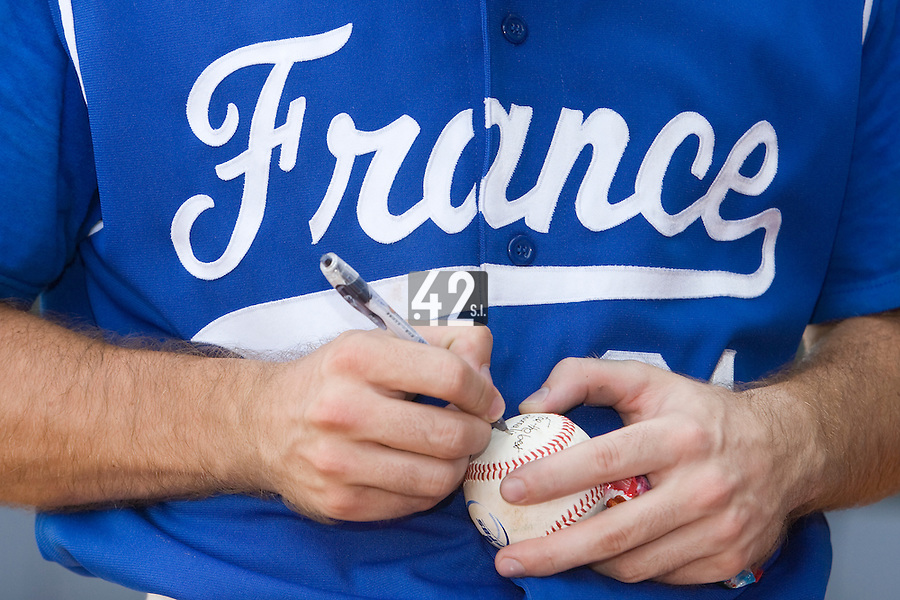 23 August 2007: #24 Gaspard Fessy signs autograph after the France 8-4 victory over Czech Republic in the Good Luck Beijing International baseball tournament (olympic test event) at the Wukesong Baseball Field in Beijing, China.