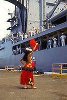 A Tahitian dancer performs for sailors returning to Pearl Harbor after a long journey at sea.