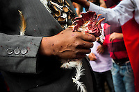 """A native from the Kamentsá tribe holds a rooster's head torn off during a ritual of the Carnival of Forgiveness, a traditional indigenous celebration in Sibundoy, Colombia, 12 February 2013. Clestrinye (""""Carnaval del Perdón"""") is a ritual ceremony kept for centuries in the Valley of Sibundoy in Putumayo (the Amazonian department of Colombia), a home to two closely allied indigenous groups, the Inga and Kamentsá. Although the festival has indigenous origins, the Catholic religion elements have been introduced and merged with the shamanistic tradition. Celebrating annually the collaboration, peace and unity between tribes, they believe that anyone who offended anyone may ask for forgiveness this day and all of them should grant pardons."""