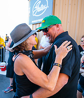 Jul 21, 2019; Morrison, CO, USA; NHRA pro stock driver Richard Freeman (right) greets Kay Torrence during the Mile High Nationals at Bandimere Speedway. Mandatory Credit: Mark J. Rebilas-USA TODAY Sports