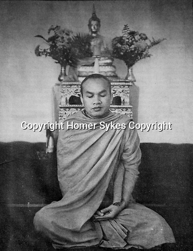 Buddhist monk, Chao Khun Sobhana Dhammasudhi or Dammasudhi is the director of the Vipassana Meditation Centre, Hindhead. Surrey, UK. 1970s.<br /> Copied from The Listener weekly magazine 12 November 1970 issue.