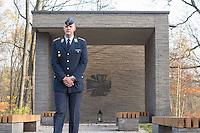 """Auf dem Gelaende des Einsatzfuehrungskommando der Bundeswehr, der Henning-von-Tresckow-Kaserne bei Potsdam, wurde ein Ehrenhain zum Gedenken an die im Einsatz verstorbenen Bundeswehrangehoerigen eingerichtet. In diesem """"Wald der Erinnerunge"""" sind die Gedenkhaine aus den Einsatzgebieten der Bundeswehr errichtet worden. Zum Teil originalgetreu nachgebildet von den Orten in denen die Bundeswehr eingesetzt war und Angehoerige verstorben sind.<br /> Im Bild: Hauptmann der Luftwaffe M. Wils-Kudiabor vor dem """"Ort der Stille"""".<br /> 14.11.2014, Potsdam<br /> Copyright: Christian-Ditsch.de<br /> [Inhaltsveraendernde Manipulation des Fotos nur nach ausdruecklicher Genehmigung des Fotografen. Vereinbarungen ueber Abtretung von Persoenlichkeitsrechten/Model Release der abgebildeten Person/Personen liegen nicht vor. NO MODEL RELEASE! Don't publish without copyright Christian-Ditsch.de, Veroeffentlichung nur mit Fotografennennung, sowie gegen Honorar, MwSt. und Beleg. Konto: I N G - D i B a, IBAN DE58500105175400192269, BIC INGDDEFFXXX, Kontakt: post@christian-ditsch.de<br /> Urhebervermerk wird gemaess Paragraph 13 UHG verlangt.]"""