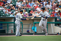 Columbus Clippers manager Rouglas Odor (24) congratulates Richie Shaffer (8) after hitting a two run home run during a game against the Rochester Red Wings on August 9, 2017 at Frontier Field in Rochester, New York.  Rochester defeated Columbus 12-3.  (Mike Janes/Four Seam Images)