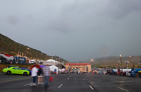 Jul 20, 2019; Morrison, CO, USA; Overall view of the staging lanes behind the starting line during a rain delay to NHRA qualifying for the Mile High Nationals at Bandimere Speedway. Mandatory Credit: Mark J. Rebilas-USA TODAY Sports