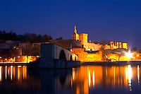 The Pont Saint St Benezet bridge in Avignon and the Pope's Palace on the Rhone at sunset, Vaucluse, Rhone, Provence, France