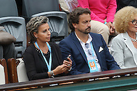Henri Leconte and girlfriend seen watching tennis during Roland Garros tennis open 2016 on may 28 2016.