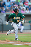 Ivan Castillo (12) of the Lynchburg Hillcats hustles down the first base line against the Winston-Salem Dash at BB&T Ballpark on May 29, 2015 in Winston-Salem, North Carolina.  The Dash defeated the Hillcats 8-1.  (Brian Westerholt/Four Seam Images)