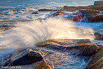 Waves splash the rocky coast at Halibut Point State Park in Rockport, Massachusetts, USA