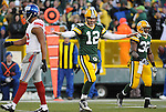 Green Bay Packers quarterback Aaron Rodgers makes a playful 'safe' motion after sliding feet-first for a first down against the New York Giants during the first quarter of the game at Lambeau Field in Green Bay, Wis., on Dec. 26, 2010. Rodgers missed the game against the New England Patriots due to a concussion he suffered against the Detroit Lions after failing to slide fee-first on a scramble.