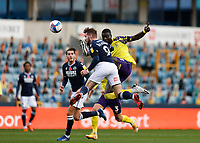 31st October 2020; The Den, Bermondsey, London, England; English Championship Football, Millwall Football Club versus Huddersfield Town; Mouhamadou-Naby Sarr of Huddersfield Town challenges Tom Bradshaw of Millwall