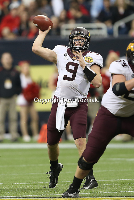 Minnesota Golden Gophers quarterback Philip Nelson (9)in action during the Meineke Car Care Bowl game of Texas between the Texas Tech Red Raiders and the Minnesota Golden Gophers at the Reliant Stadium in Houston, Texas. Texas defeats Minnesota 34 to 31.