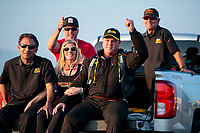 Feb 8, 2020; Pomona, CA, USA; NHRA funny car driver Alex Miladinovich celebrates with crew members after qualifying for the Winternationals at Auto Club Raceway at Pomona. Mandatory Credit: Mark J. Rebilas-USA TODAY Sports