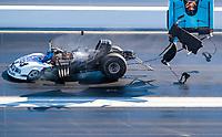 Nov 1, 2020; Las Vegas, Nevada, USA; NHRA funny car driver Blake Alexander explodes the carbon fiber body off his car during the NHRA Finals at The Strip at Las Vegas Motor Speedway. Alexander was unhurt in the incident. Mandatory Credit: Mark J. Rebilas-USA TODAY Sports