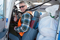 Volunteer Iditarod Air Force pilot, Scott Ivany gives the thumbs up as hee readies to take a plane load of hay, musher drop bags, people food and HEET to Rainy Pass at the Willow, Alaska airport during the Food Flyout on Saturday, February 20, 2016.  Iditarod 2016