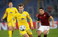 Calcio, Champions League: Gruppo E - Roma vs Bate Borisov. Roma, stadio Olimpico, 9 dicembre 2015.<br /> Bate Borisov's Denis Polyakov, left, is chased by Roma's Juan Iturbe during the Champions League Group E football match between Roma and Bate Borisov at Rome's Olympic stadium, 9 December 2015.<br /> UPDATE IMAGES PRESS/Riccardo De Luca