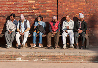 Nepal, Patan.  Five Men, One Woman, Resting on a Bench in Durbar Square.