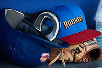 A High Point Rockers cap sits on top of a glove in the dugout during the game against the Southern Maryland Blue Crabs at Truist Point on June 18, 2021, in High Point, North Carolina. (Brian Westerholt/Four Seam Images)