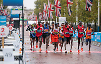 4th October 2020, London, England; 2020 London Marathon; Eliud Kipchoge (KEN) and the lead group take a drink on The Mall during the Elite Men's Race. The historic elite-only Virgin Money London Marathon taking place on a closed-loop circuit around St James's Park in central London on Sunday 4 October 2020.