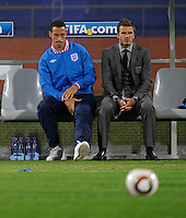 Rio Ferdinand holds his injured leg while he sits next to David Beckham. USA tied England 1-1 in the 2010 FIFA World Cup at Royal Bafokeng Stadium in Rustenburg, South Africa on June 12, 2010.