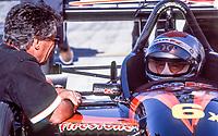 Mario Andretti, L, talks with Michael Andretti, Marlboro Grand Prix of Miami, CART race, March 26, 2000.  (Photo by Brian Cleary/bcpix.com)