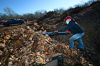 Scott Hamilton of Fayetteville unloads the last of three loads of leaves Tuesday, Nov. 17, 2020, at the city of Fayetteville's Compost Facility at 1708 S Armstrong Ave. Residents are invited to drop off leaves and yard waste at the facility from 8 a.m. to 3 p.m. on Tuesdays and Thursdays and 8 a.m. to noon on the first Saturday of the month until spring. City staff asks that residents use compostable bags and avoid leaving rocks or metal in the leaves because of very costly damage to the city's chipper machine. Yard waste and food waste are composted and sold as it becomes available. Visit nwaonline.com/201118Daily/ for today's photo gallery. <br /> (NWA Democrat-Gazette/Andy Shupe)