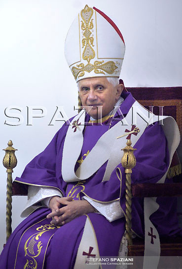 Pope Benedict XVI listens on during a visit at a SMOM Sovereign Military Order of Malta hospital in Rome, Sunday, Dec. 2, 2007.