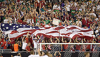 USA fans hold a large flag in celebration. USA 2, Mexico 0, at the University of Phoenix Stadium in Glendale, AZ on February 7, 2007.