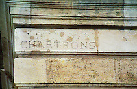 "An old street sign carved in stone on a building in Bordeaux: ""Chartrons"" meaning Quai des Chartrons, which used to be the centre of the wine trade. Bordeaux City, Gironde Aquitaine France Europe"