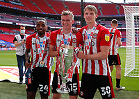 29th May 2021; Wembley Stadium, London, England; English Football League Championship Football, Playoff Final, Brentford FC versus Swansea City; Tariqe Fosu, Marcus Forss and Mads Roerslev of Brentford all celebrates with the Sky Bet EFL Championship Plays-off Trophy and their 2-0 win and promotion to the Premier League