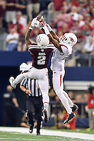 Arkansas cornerback Jared Collins (29) breaks a pass intended for Texas A&M wide receiver Speedy Noil (2) during an NCAA Football game, Saturday, September 27, 2014 in Arlington, Tex. Arkansas leads 21-14 at the halftime. (Mo Khursheed/TFV Media via AP Images)