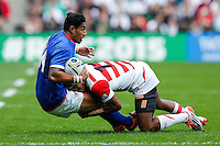 Samoa Winger Ken Pisi is tackled by Japan Winger Kotaro Matsushima - Mandatory byline: Rogan Thomson - 03/10/2015 - RUGBY UNION - Stadium:mk - Milton Keynes, England - Samoa v Japan - Rugby World Cup 2015 Pool B.