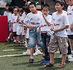 Kids attend the coaching clinic with Hong Kong players at the Hong Kong Football Club on 20 April 2013 in Hong Kong. Photo by Xaume Olleros / The Power of Sport Images