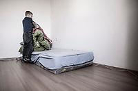 Junge macht sein Bett, Hartz IV, Bochum<br /> <br /> *** HighRes auf Anfrage *** Voe nur nach Ruecksprache mit dem Fotografen *** Sonderhonorar ***<br /> <br /> <br /> Engl.: Europe, Germany, Bochum, unemployment benefit, Hartz IV, unemployed, unemployment, poverty, poor, social benefits, child, boy making his bed, room, mattress, portrait, 28 March 2012<br /> <br /> ***Highres on request***publication only after consultation with the photographer***special fee***