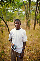 """18 year old Brian Mushamba from Chalilo school in Sereje district, on his first safari in Kasanka National Park. """"To African people, animals have scenic beauty - they look beautiful - and at some point they are used as meat. Most of the parents don't even understand why a National Park should be there but my parents told me that if we didn't have NPs then we wouldn't be able to see any more species. They have never been to a National Park. My favourite animal is a zebra because of the stripes. I have only seen it in pictures not in real life.""""  Local schools and women's groups are regularly brought into Kasanka, which is unique in the country and unusual in Africa as it is privately managed and owned by a trust. People are able to see animals flourishing in land which was once free reign for poachers. Combined with anti-poaching scouts, the education programme is on the frontline of conservation methods in the park, showing local people wild animals in their natural habitat."""
