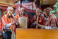 Peru.  Peruvian Quechua Indian Musicians Playing on Inca Rail Executive Class Train from Ollantaytambo to Machu Picchu.