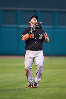 Fresno Grizzles outfielder Robbie Grossman (15) tracks down a fly ball during a game against the Oklahoma City Dodgers on June 1, 2015 at Chickasaw Bricktown Ballpark in Oklahoma City, Oklahoma.  Fresno defeated Oklahoma City 14-1.  (Mike Janes/Four Seam Images)