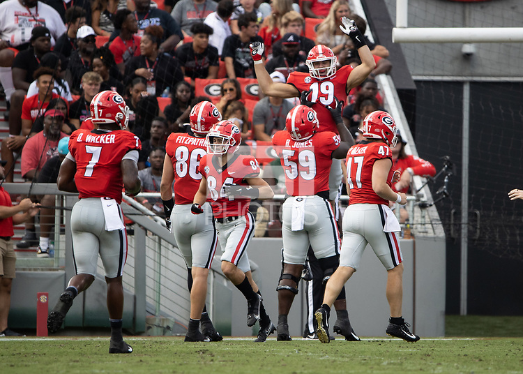 ATHENS, GA - SEPTEMBER 11: Brock Bowers #19 celebrates with his teammates after catching a touchdown pass during a game between University of Alabama Birmingham Blazers and University of Georgia Bulldogs at Sanford Stadium on September 11, 2021 in Athens, Georgia.