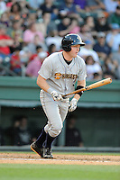 First baseman Connor Spencer (33) of the Charleston RiverDogs bats in a game against the Greenville Drive on Sunday, May 24, 2015, at Fluor Field at the West End in Greenville, South Carolina. Charleston won 3-2. (Tom Priddy/Four Seam Images)