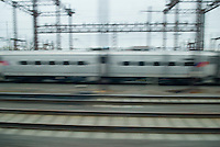 Commuter Train in Rail Yard Viewed from the Window of Another Moving Passenger Train, New Jersey, USA