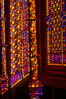 Resembling the interior of a child's kaleidoscope ornate stained glass windows create a vividly psychedelic atmosphere