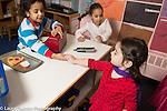 Preschool 4 year olds boy and two girls playing store