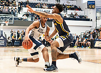WASHINGTON, DC - FEBRUARY 22: Jameer Nelson Jr. #12 of George Washington pushes into Sherif Kenney #4 of La Salle during a game between La Salle and George Washington at Charles E Smith Center on February 22, 2020 in Washington, DC.