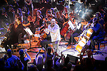 """© Joel Goodman - 07973 332324 . 05/02/2016 . Manchester , UK . NICKY LOCKETT ( MC Tunes ) emcees .  """" Hacienda Classical """" debut at the Bridgewater Hall . The 70 piece Manchester Camerata and performers including New Order's Peter Hook , Shaun Ryder , Rowetta Idah , Bez and Hacienda DJs Graeme Park and Mike Pickering mixing live compositions . Photo credit : Joel Goodman"""