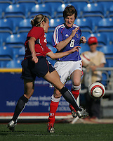 MAR 13, 2006: Faro, Portugal:   USWNT defender (2) Heather Mitts clears the ball away from France midfielder (8) Sonia Bompastor in the Algarve Cup in Faro Portugal.